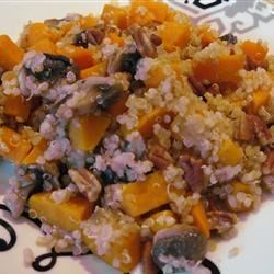 Quinoa with Sweet Potato and Mushrooms Recipe - Sweet potato, onion, mushrooms, and chopped pecans are served over a bed of quinoa. This dish is perfect as a warm meal or side dish during cold weather.
