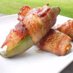 Bacon Jalapeno Pepper Chicken Bites Recipe - Try this recipe for chicken-stuffed jalapeno peppers wrapped in bacon and grilled. It's a nice change from the ones stuffed with cream cheese.