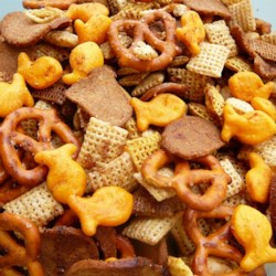 Soccer Chex(R) Mix Recipe - This buttery snack mix is perfectly seasoned with a variety of cereals, pretzels, bagel chips, and peanuts that was so popular the school soccer team has been named 'soccer snack mix'.