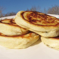 Fluffy Canadian Pancakes Recipe - Separating the eggs and folding the whipped whites into the batter creates a fluffy pancake that will melt in your mouth.