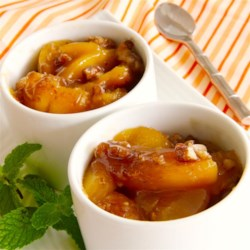 Baked Peaches Recipe - Use frozen peach slices in this easy baked dessert recipe with pecans, brown sugar, and vanilla extract.