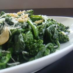 Maria's Broccoli Rabe Recipe and Video - Broccoli rabe (rapini) sauteed with garlic and dusted with Parmesan cheese.