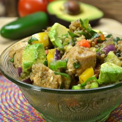 Mexican Chicken Quinoa Salad Recipe - Chicken, quinoa, avocado, and jalapeno peppers are tossed with salsa in this hearty and easy Mexican quinoa dish.