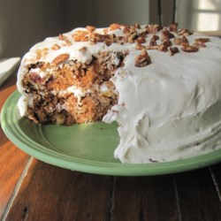 Sam's Famous Carrot Cake Recipe - This carrot cake recipe combines carrots, pineapple, raisins, and walnuts to make a moist and satisfying dessert.