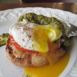 Poached Eggs Caprese Recipe - Inspired by eggs Benedict, poached eggs sit atop slices of tomato and mozzarella cheese in this delicious vegetarian breakfast.