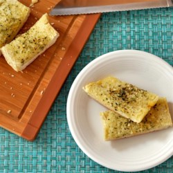 Crusty Garlic Bread Recipe - Make your own garlic bread with this quick and easy recipe that will be a welcome addition to your dinner table.