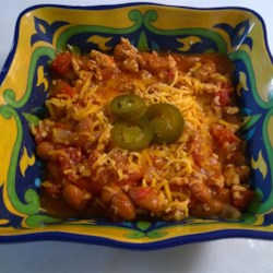 Hill Country Turkey Chili with Beans Recipe - This turkey chili recipe uses beans, beef broth, and plenty of tomatoes for a tasty, hearty pot of chili.