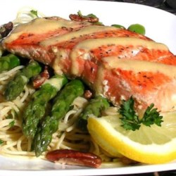 Salmon With  Dijon Butter Sauce, Asparagus and Herb Butter Angel Hair Pasta Recipe - Delicate angel hair pasta tossed in buttery herbs forms a base for asparagus spears cooked with pecans, topped with a salmon fillet and a butter-Dijon mustard sauce. It's an elegant but surprisingly quick meal that's sure to impress.