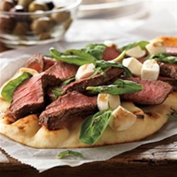 Grilled Steak and Fresh Mozzarella Flatbread Recipe - Steak meet salad. Salad meet pizza. A tasty introduction has been made.