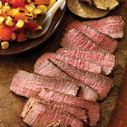Grilled Southwest Steaks with Sunset Salad Recipe - Eye of Round steaks, grilled to perfection, served with a colorful corn, pepper, and tomato sunset salad.