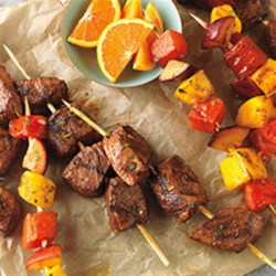 Citrus-Marinated Beef & Fruit Kabobs Recipe - Cubes of Top Sirloin are marinated for flavor in a mixture of orange peel, cilantro and smoked paprika. They are then grilled alongside skewers of watermelon, peaches, and mango.
