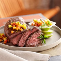 Grilled Beef Tri-Tip with Tropical Fruit Salsa Recipe - Tri-Tip roast is grilled and brushed with a lime-honey glaze during cooking. A quick salsa including papaya, jalapeno and lime brightens up the finished dish.