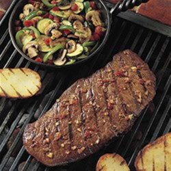 Grilled Southwestern Steak and Colorful Vegetables Recipe - Fire up the grill and try this delicious southwestern marinade on Top Round Steak paired with flavorful zucchini, mushrooms, and bell peppers.