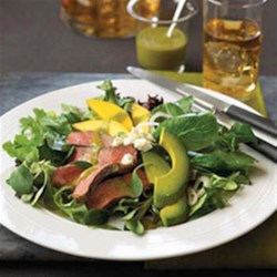 Pepper Steak Salad with Mango, Avocado and Jalapeno Vinaigrette Recipe - Combine juicy pepper steak with crisp salad greens and add delicious mango, avocado and cheese to make this fresh and light salad. Top it off with a homemade spicy Jalapeño Vinaigrette to complete the dish.