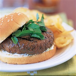 Firecracker Burgers with Cooling Lime Sauce Recipe - These burgers are spiced with curry powder and Caribbean jerk seasoning and topped with a refreshing sauce of yogurt and lime.