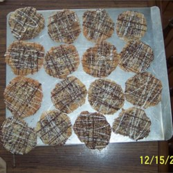 Lacy Oatmeal Cookies Recipe - This dough spreads to make thin, lacy, oatmeal cookies that you peel off the cookie sheet. Great served with ice cream, or rolled into tubes while still warm and dipped in chocolate.