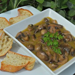 Jean's Marinated Mushrooms Recipe - Sauteed mushrooms are marinated in a tarragon vinegar-enhanced salad dressing mixture.