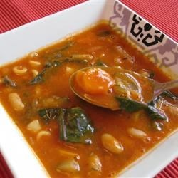 Andrea's Pasta Fagioli Recipe - Tomato sauce, cannelini beans, navy beans and ditalini pasta are seasoned with parsley, basil and oregano in this chunky soup.