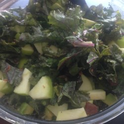Kale, Apple, Avocado, and Bacon Salad Recipe - This great way to use kale has everything you could want in a salad: the creaminess of avocado, the tanginess of apple, the crunch of almonds, and, of course, the delicious magic of bacon.