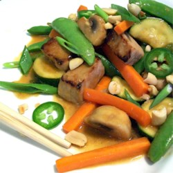 Spicy Pork Stir-Fry Recipe - Control the chile and you control the heat in this pork and vegetable stir-fry. Morsels of marinated pork are cooked quickly with ginger, carrots and fresh sugar peas, and then flavored with lime juice, soy, vinegar and sesame oil. Add chile oil to taste.