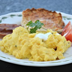 Scrambled Eggs Fraiche Recipe - Scramble a few eggs in butter and olive oil with parsley and creme fraiche to create this creamy egg dish; guaranteed to please at your breakfast table!