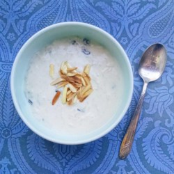 Kheer (Rice Pudding) Recipe - This is a very flavorful Basmati rice pudding made with coconut milk, raisins, cardamom, and toasted almonds and pistachios. It's the best rice pudding I've ever had, and very easy to make!