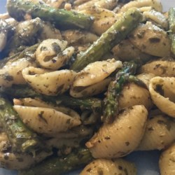 Pasta with Asparagus Pesto Recipe - Asparagus is the secret ingredient in this new twist on pesto. Serve with orecchiette pasta and Pecorino-Romano cheese for an Italian-inspired meal.