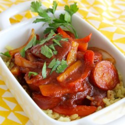 BBQ Hotdogs on Rice Recipe - Kielbasa simmered in molasses and tomato sauce. Served warm over rice (or try mashed potatoes). Quick and easy!