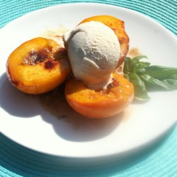 Baked Peaches 'n Cream Recipe - Baked peaches with brown sugar and butter and topped with vanilla ice cream creating a crowd-pleasing peaches and cream dessert.
