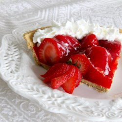 Fresh Berry Pie Recipe - Fresh strawberries are stirred into a cooked strawberry gelatin filling and spooned into a pre-baked crumb crust. This pretty, sweet pie is then chilled and served with whipped cream. Or if you like, make this pie with peaches.