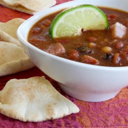 Casablanca Chili Recipe - Spice up your leftover ham with lime juice, mango chutney and peanut butter simmered into a deliciously nontraditional chili. Brown sugar, allspice, raisins, chickpeas, chili beans, tomatoes and green chili peppers jump into the chili pot too!