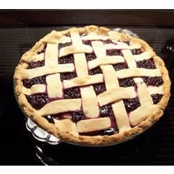 Elderberry Pie II Recipe - This pie is pure elderberry with sugar, a hint of lemon juice, and cornstarch stirred in. The top crust is latticed so when you take it from the oven, you can see the beautiful berries and bubbly sauce glisten through it.