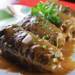 German Beef Rouladen Recipe - Thin steaks are wrapped around bacon and onions, pan-fried, and then simmered in beef broth, which is, in turn, made into a sour-cream gravy in this traditional German recipe. Guten Appetit!