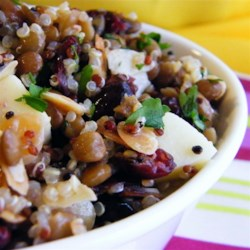 Cranberry Lentil and Quinoa Salad Recipe - This vibrant quinoa lentil salad has a delicious lemon-honey dressing. Crumbled feta adds a salty zing, while the dried cranberries and walnuts add texture.