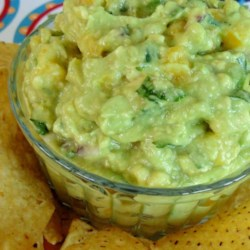 Mango-Tomatillo Guacamole Recipe - Mango and tomatillos add layers of flavor to this guacamole recipe also featuring mint. Quick, easy, and delicious.