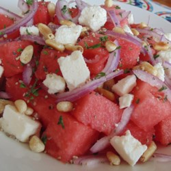Tisa's Big Top Watermelon Salad Recipe - Nothing says summer like juicy watermelon tossed with feta, onions, pine nuts, and fresh herbs.