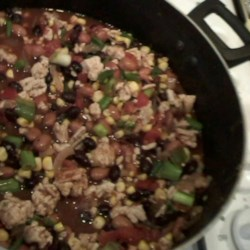 Healthy Turkey Tex Mex Chili Recipe - This thick chili is made with black beans, tomatoes, ground turkey, corn, and plenty of spices.