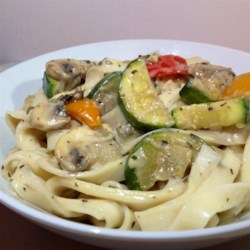 Creamy Pasta with Zucchini Recipe - Just a handful of ingredients go into this quick and creamy pasta toss; it's a great way to take advantage of a bumper crop of zucchini.