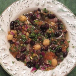 Balela (Chickpea and Black Bean Salad) Recipe - Balela, a Middle Eastern-inspired salad, combines chickpeas, black beans, parsley, and lemon juice together into a quick and easy meal.