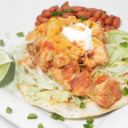 Yummy Chicken Burritos Recipe - Yummy chicken burritos are a kid-pleasing dinner item that uses the meat from a whole chicken simmered in a spicy tomato broth for the filling.