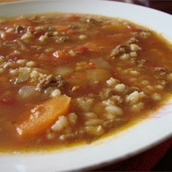 Hearty Hamburger Soup Recipe - This thick and hearty hamburger soup is loaded with vegetables and barley.
