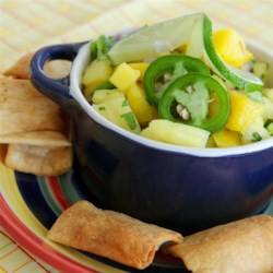 Mango Pineapple Salsa Recipe - Mango and pineapple are mixed with a little jalapeno, lime juice, and cilantro for this simple and delicious salsa.