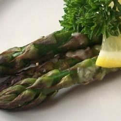 Asparagus with Parmesan Crust Recipe - Tender asparagus is adorned with melted Parmesan cheese and served with balsamic vinegar!