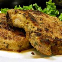 Breaded Lemon Zest Pork Chops Recipe - Coat pork chops with a mixture of break crumbs, garlic, parsley, and lemon zest to get this delicious main dish.