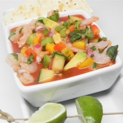 Light and Fresh Mexican Gazpacho Recipe - A fresh cold soup with a hint of spiciness has plenty of colorful vegetables including cucumbers, avocados, red and yellow peppers, and cilantro in a tomato base. Add small shrimp to make a nice main course or eat as is for a light lunch or appetizer.