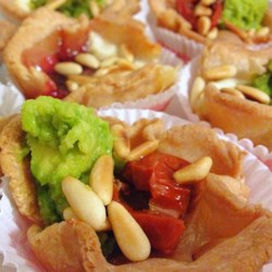 Dinner in a Puff Recipe - Puff pastry cups are stuffed with goat cheese and topped with either avocado or jam for a sweet or savory appetizer everyone will love.