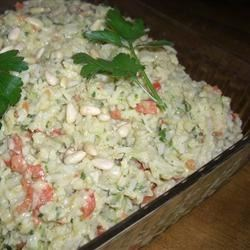 Artichoke Rice Salad Recipe - The curry powder mixed into the mayonnaise makes all the difference. You can substitute wild rice instead of white or use a packaged pilaf mix as well. It also molds nicely and mellows in the refrigerator.