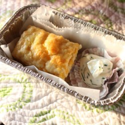 Cheddar Biscuits with Chive Butter Recipe - Fresh chive butter pairs with Cheddar cheese biscuits to make this recipe that will please the whole family.