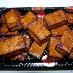 Spicy Baked Tofu Recipe - The marinade for this baked tofu is a mixture of soy sauce, hoisin sauce, Asian-style chili sauce, and fresh ginger.
