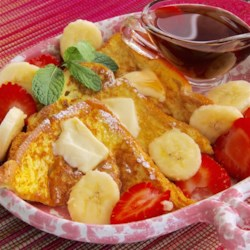 Valentine's Day French Toast Recipe - Surprise your honey on Valentine's Day morning with this wonderful French toast recipe with strawberries and bananas for garnish!